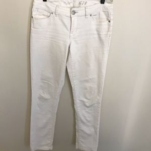 The limited white mid rise denim